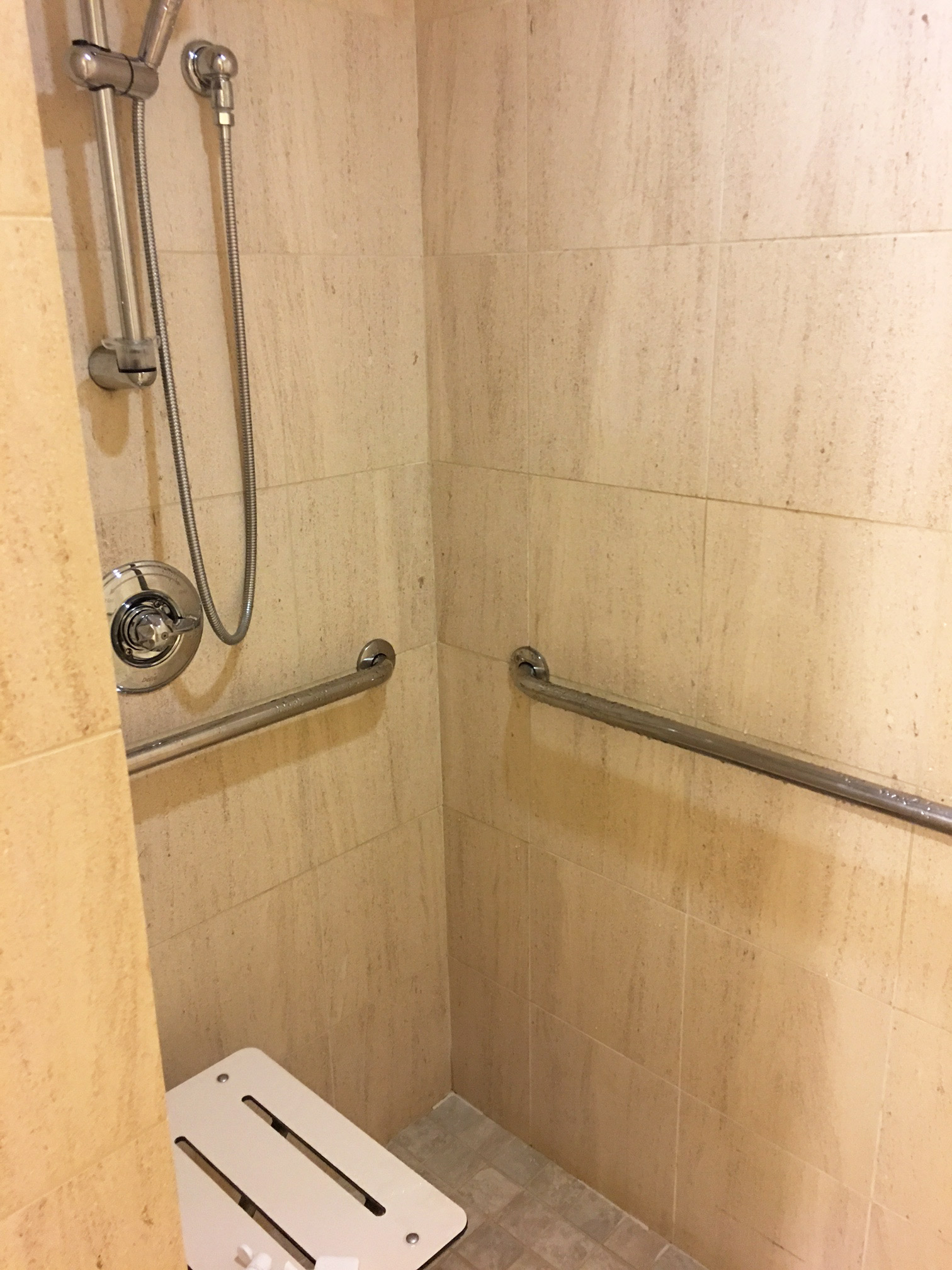 ada standards i find having a seat in a bathtub does meet the whether the person can actually use it or not and rollin showers