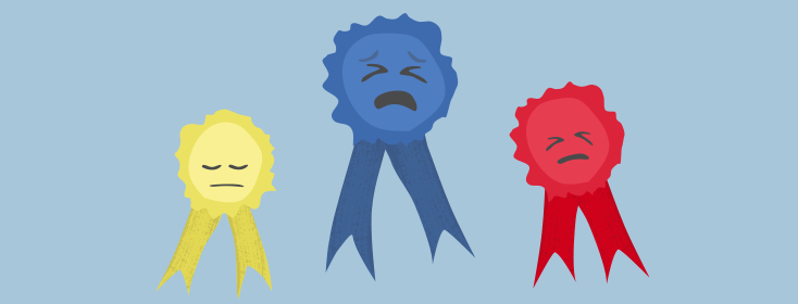a yellow, blue, and red award ribbon with crying faces drawn on
