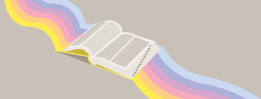 An open book with a various colors protruding from the background