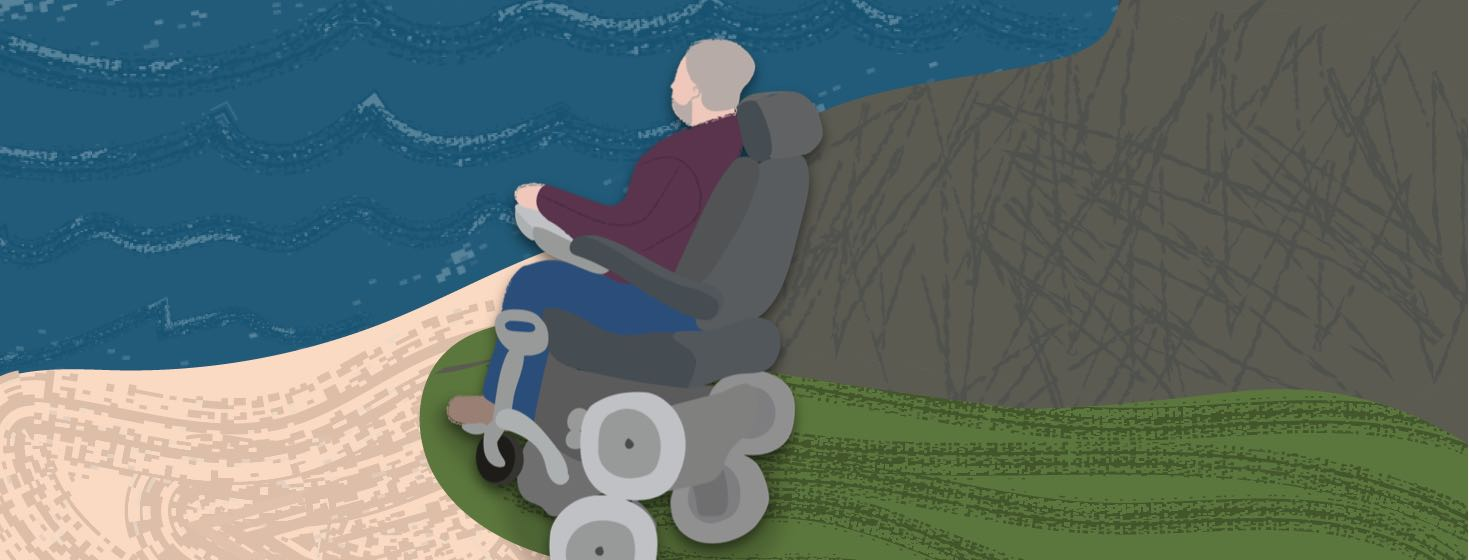 A man looking out over the ocean in his custom wheelchair