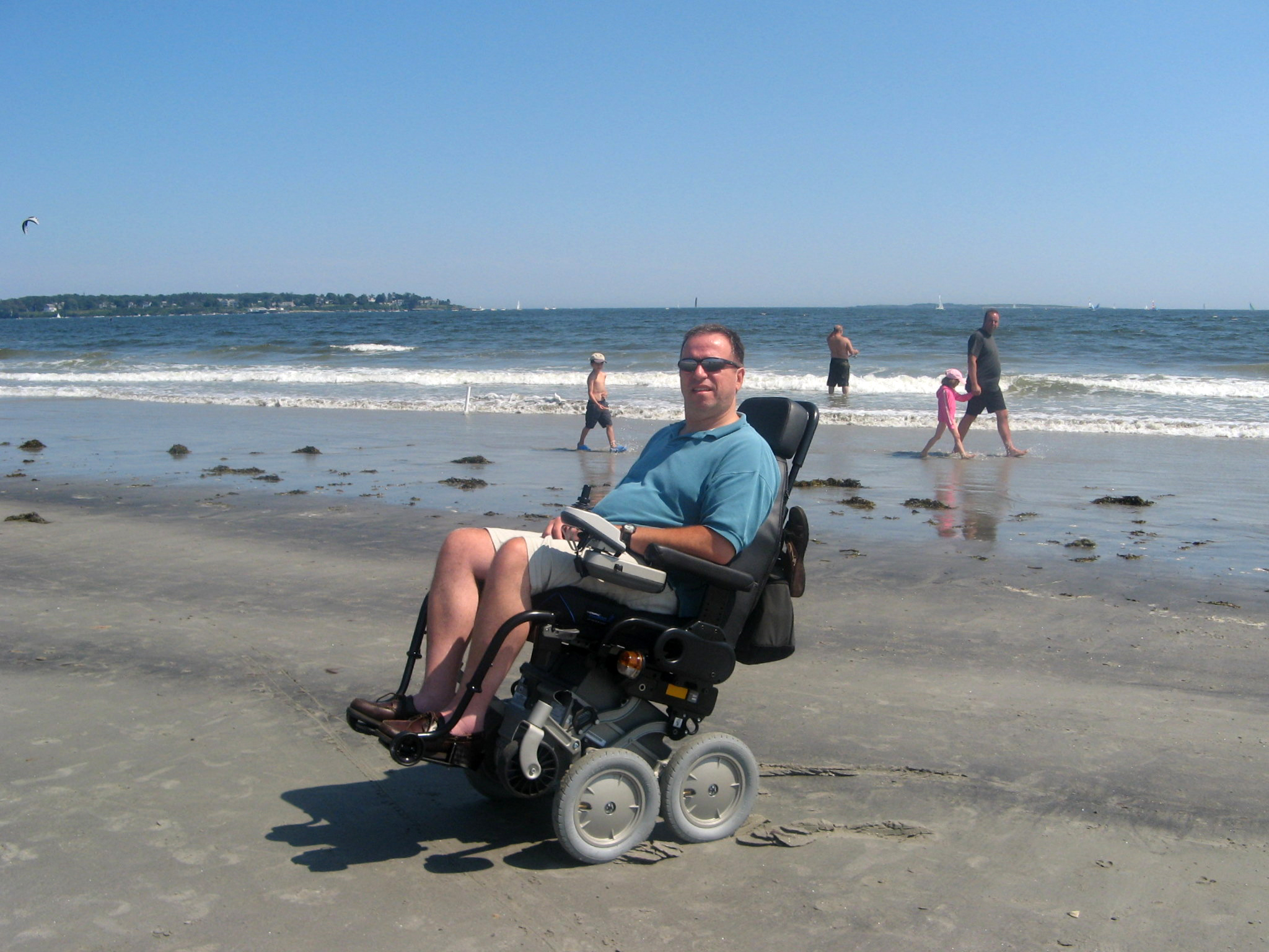 Mitch on a beach in his iBot wheelchair