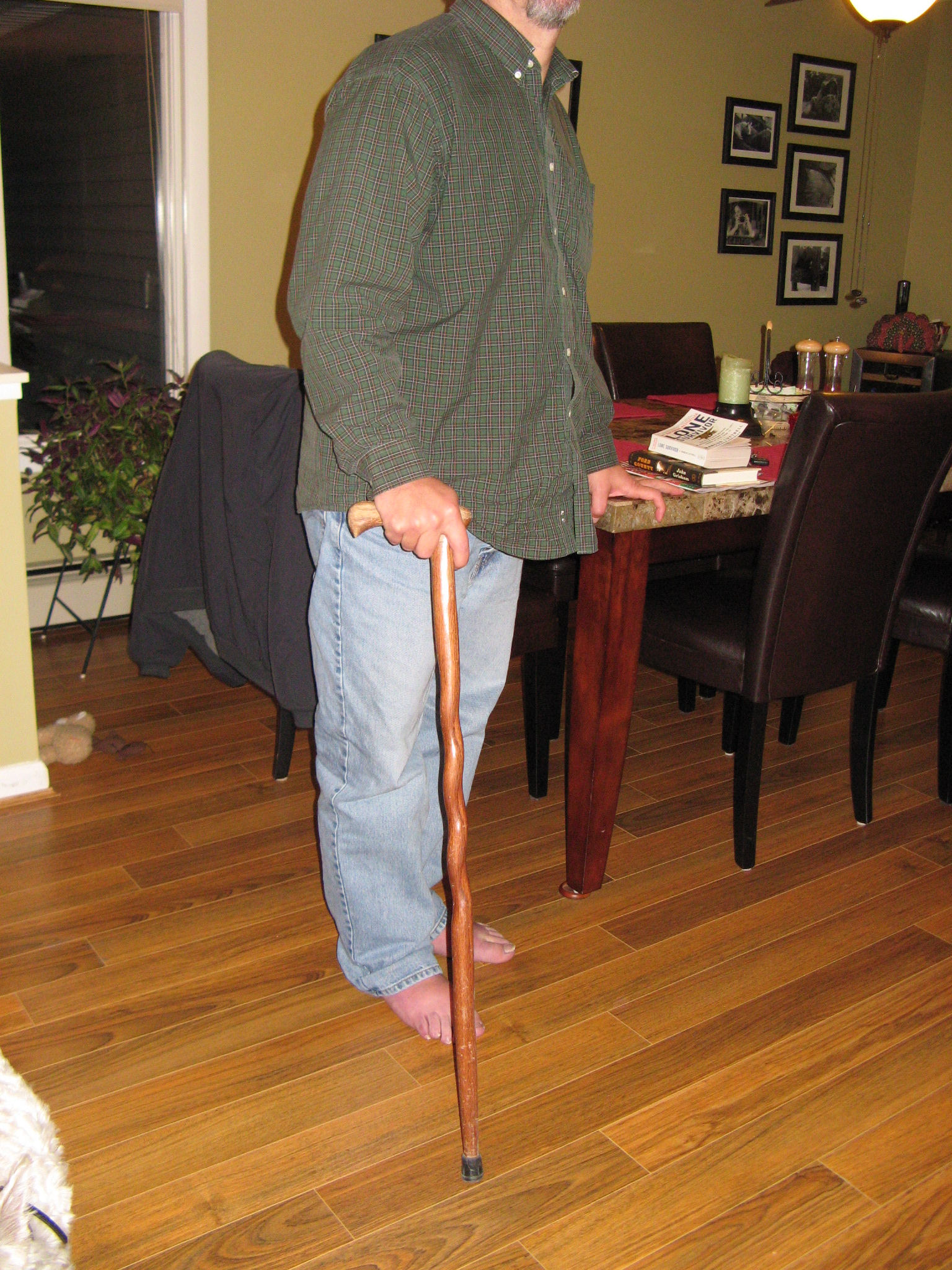 Mitch standing with his wooden cane