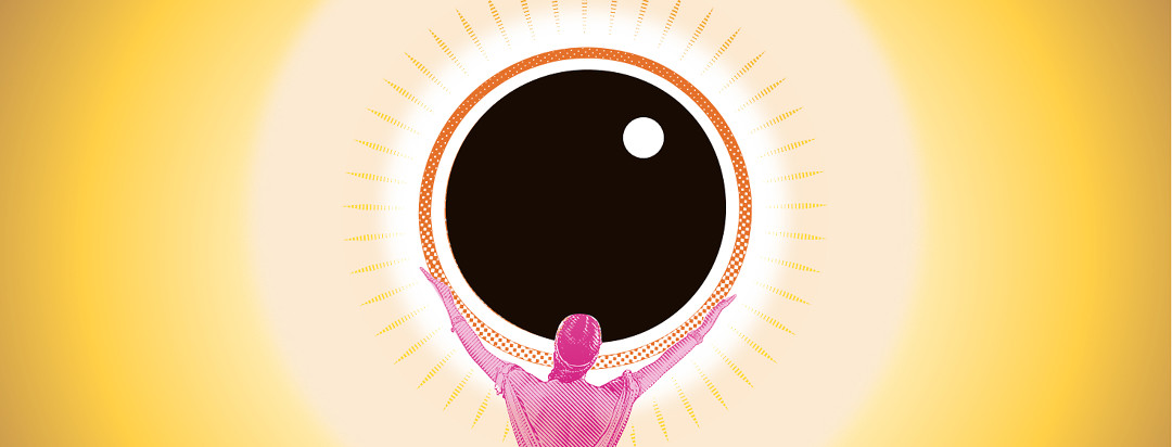 A woman holding up a giant black circle in front of the sun.
