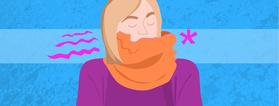 A woman with her entire neck and mouth covered in an orange scarf.