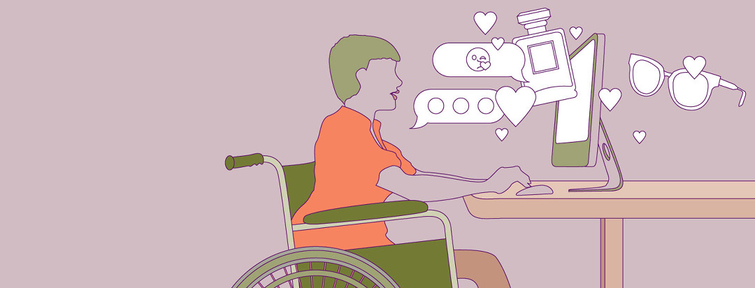 Woman in a wheelchair sitting in front of a computer with emojis and chat bubbles coming out of it