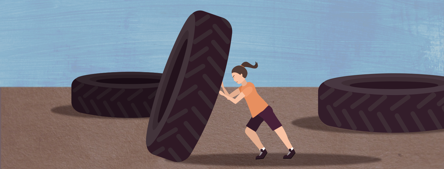 A woman trying really hard to push a tire that is bigger than her.