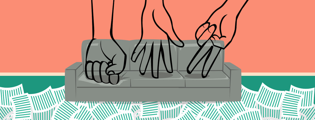 Three hands sitting on a couch. One making a fist like a rock, one laying flat like paper, and the last one is making a scissor shape. Rock, Paper, Scissors.