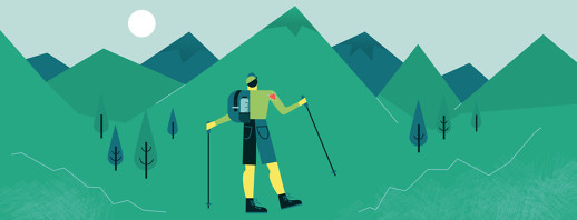 A person with hiking sticks staring up at a row of mountains with a heart sewn on the sleeve of their shoulder.