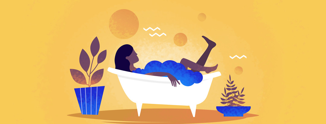 A woman relaxing in a bubble bath in a serene setting surrounded by plants.