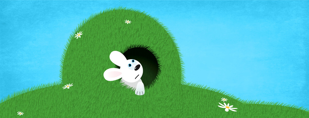 A baby rabbit looking out a rabbit hole in a hill that resembles an MRI machine.