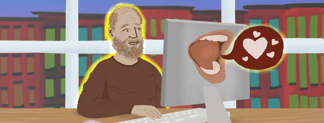 Older person with beard typing on desktop computer; mouth on back of computer relays a talk bubble with hearts in it.