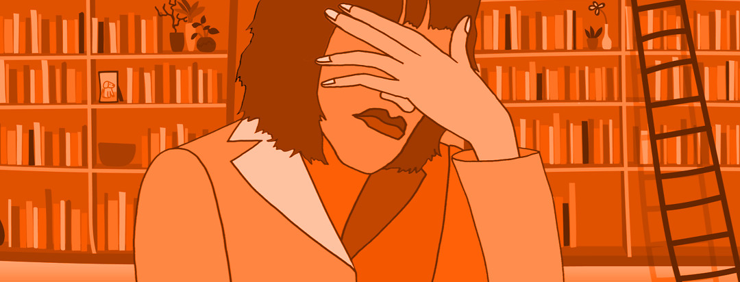 I woman looks unhappy and covers her face with her hand. Behind her are rows of bookshelves.