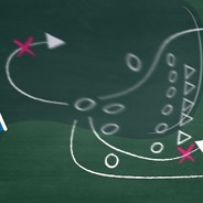 Magnifier shows a sport game-plan drawn on a chalkboard.