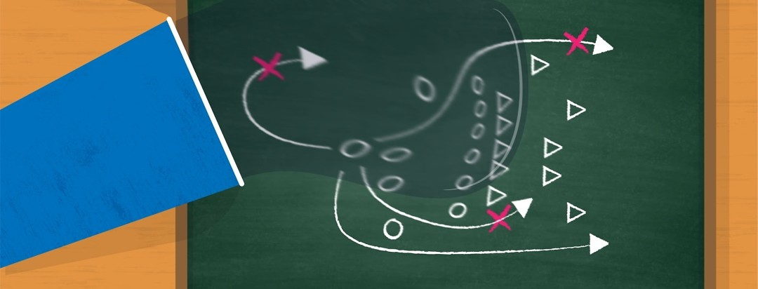 A chalkboard with a football play getting washed away by spilled water
