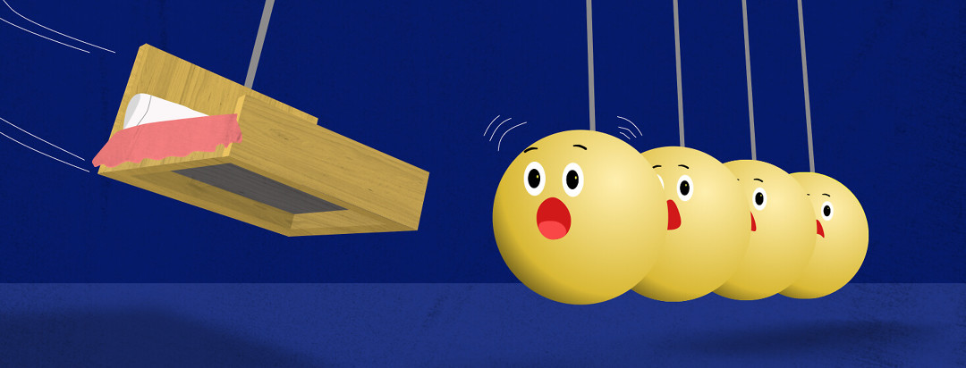 A pendulum shaped as a bed swings out and is getting ready to hit a set of 4 gold balls. Each ball has a look of terror on it's face..