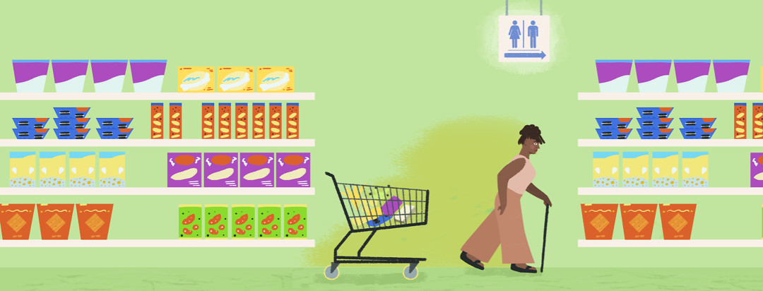 A woman with a cane abandons her grocery cart while rushing towards a bathroom sign that is hanging from the ceiling.