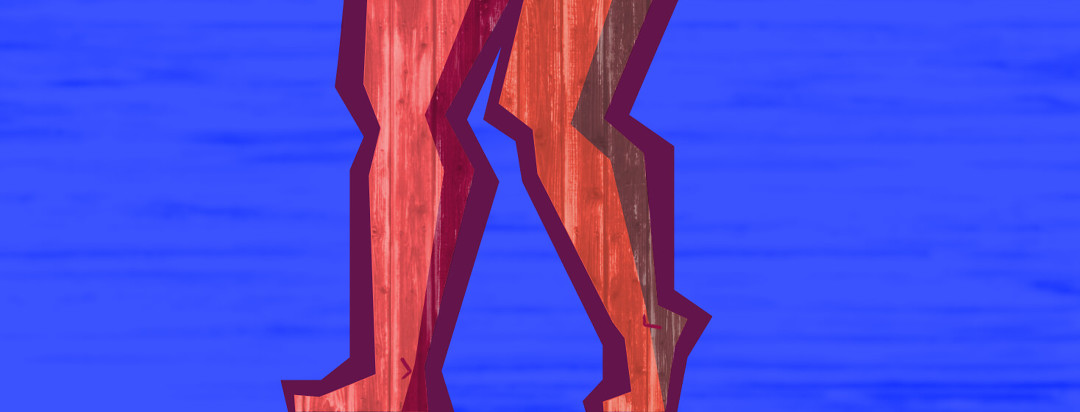 A close up of a set of legs made out of wood. The blue background is striped and blurry.