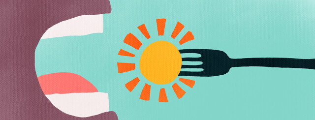 A close up of a fork with sunshine on it going in someone's mouth.